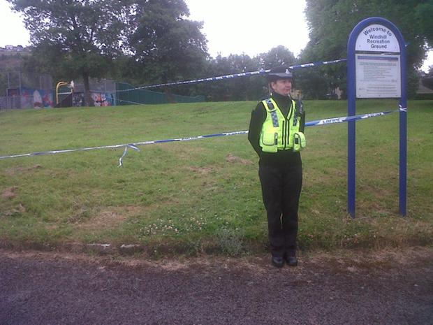 A police officer by Shipley skate park in West Yorkshire where a nine-year-old boy was stabbed yesterday