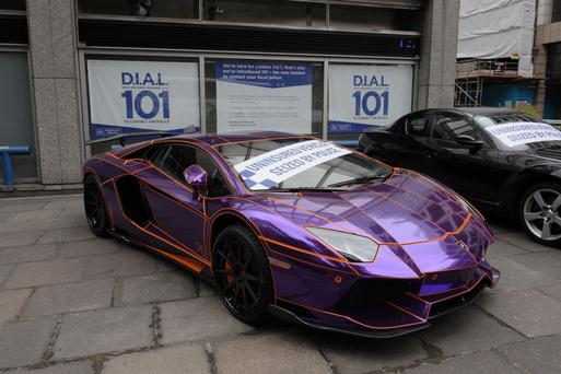 A Lamborghini Aventador, which was seized on Wilton Place in Knightsbridge by police for being driven illegally without insurance, on display outside New Scotland Yard, London.