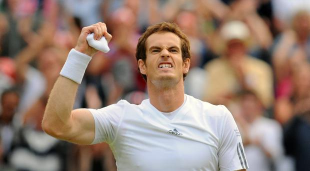 Great Britain's Andy Murray celebrates defeating Spain's Fernando Verdasco during day nine of Wimbledon