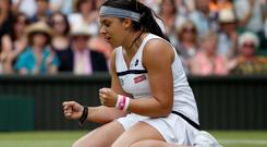 France's Marion Bartoli celebrates defeating Belgium's Kirsten Flipkens