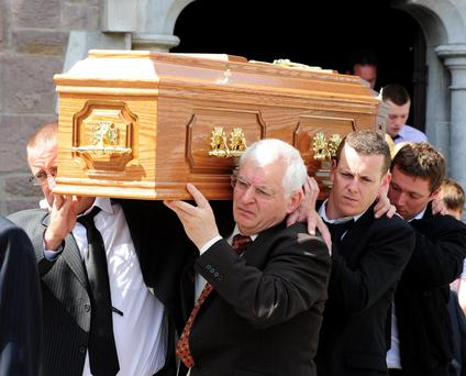 Joe Higgins TD carries the remains of his mother Nell from Dingle Church