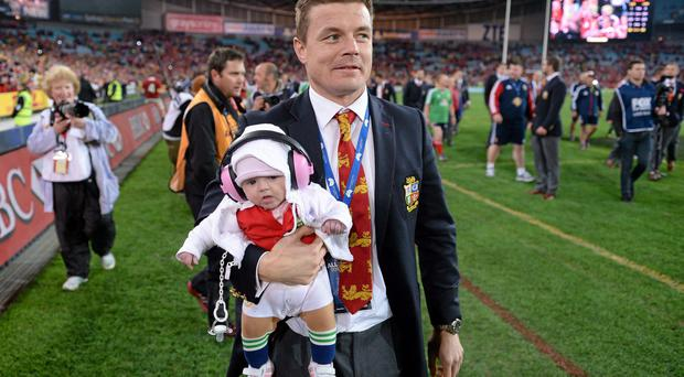 Brian O'Driscoll, British & Irish Lions, with his daughter Sadie following the game.