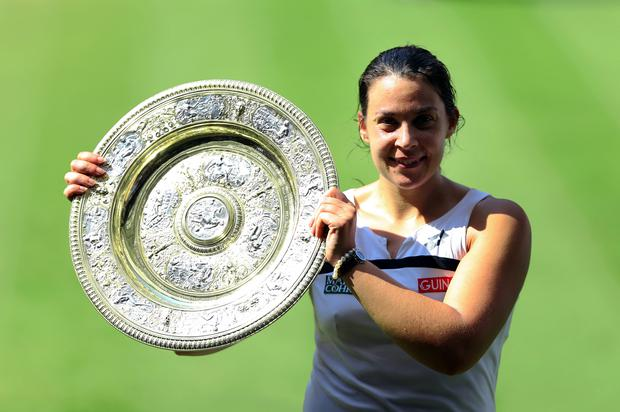 France's Marion Bartoli with the trophy