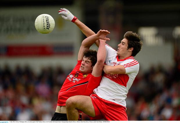 Christy McKaigue, Derry, in action against Niall Madine