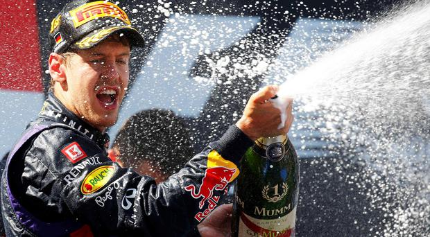 Red Bull Formula One driver Sebastian Vettel of Germany celebrates winning the German F1 Grand Prix at the Nuerburgring