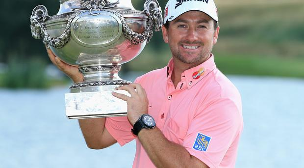 Graeme McDowell poses with the trophy after victory in the final round of the Alstom Open de France at Le Golf National