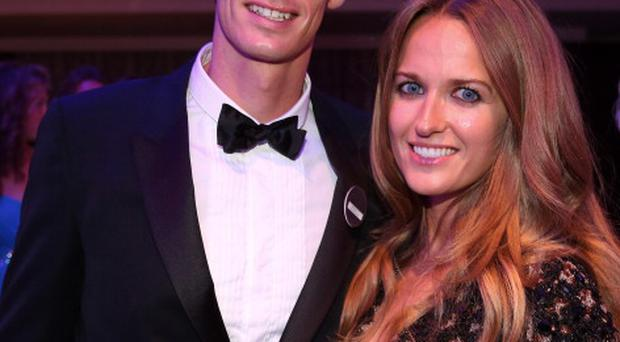LONDON, ENGLAND - JULY 07: Gentlemen's Singles Champion Andy Murray of Great Britain poses with his girlfriend Kim Sears during the Wimbledon Championships 2013 Winners Ball at InterContinental Park Lane Hotel on July 7, 2013 in London, England. (Photo by Julian Finney/Getty Images)