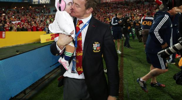 Brian O'Driscoll cuddles with his daughter Sadie on the pitch