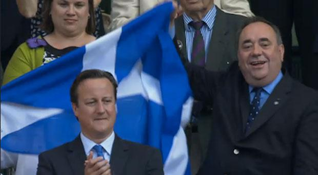 Scottish First Minister Alex Salmond has attracted criticism for raising the Saltire behind the head of David Cameron