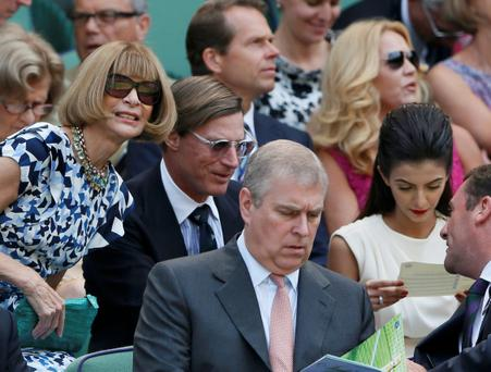 Amrican Vogue Editor-in-Chief Anna Wintour (L) and Prince Andrew (C) sit on Centre Court