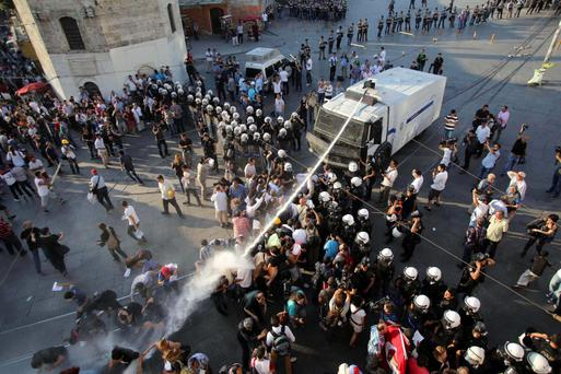 Riot police use a water cannon to disperse demonstrators during a protest at Taksim Square in central Istanbul July 6, 2013
