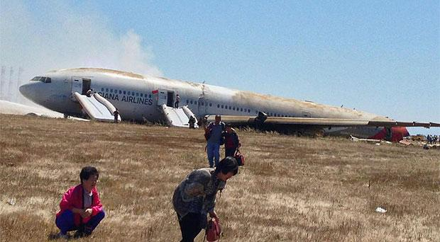Passengers flee the stricken airliner shortly after it crash-landed at San Francisco Airport