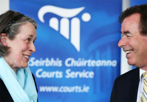 Justice Minister Alan Shatter chats with Chief Justice Susan Denham at the launch of the Courts Service Annual Report