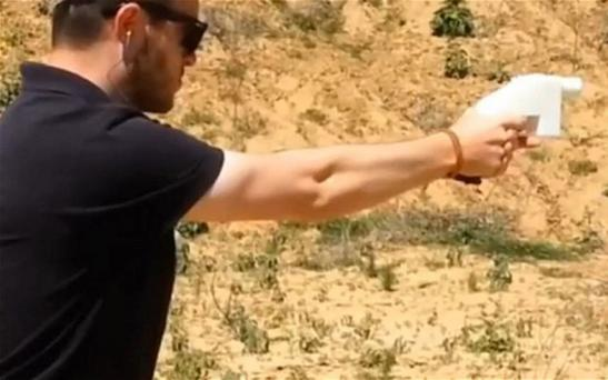 Cody Wilson, a 25-year-old law student at the University of Texas, fires the world's first gun made with 3D printer technology