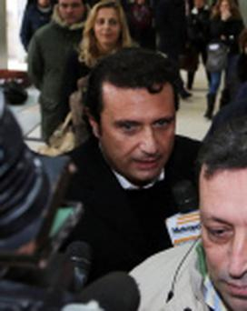 Francesco Schettino...Captian Francesco Schettino, center, speaks to the media following a closed-door hearing in Torre Annunziata's courthouse, near Naples, Italy, Wednesday, Jan. 30, 2013