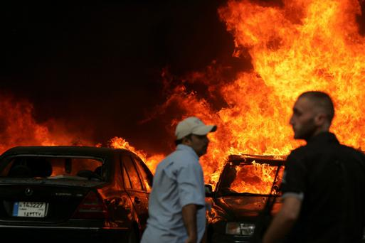 Men gather at the site of an explosion in Beirut's southern suburbs July 9, 2013