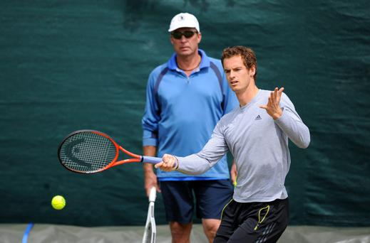 Andy Murray is watches by his coach Ivan Lendl