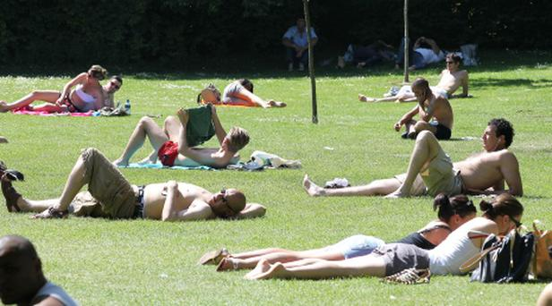 People enjoying the sunshine in St Stephens Green yesterday