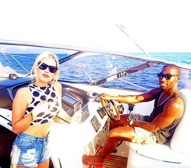 Laura shared this snap of her on a boat with Tinie Tempah in Mallorca