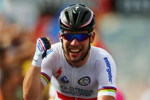 Mark Cavendish of Omega Pharma-Quick Step celebrates winning stage five of the 2013 Tour de France