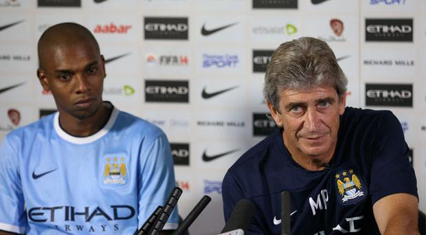 New Manchester City manager Manuel Pellegrini (right) and new signing Fernandinho during a press conference at Carrington Training Ground