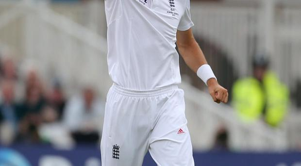 England' bowler Steven Finn celebrates taking wicket of Australia's Shaun Watson during day one of the First Investec Ashes Test match at Trent Bridge