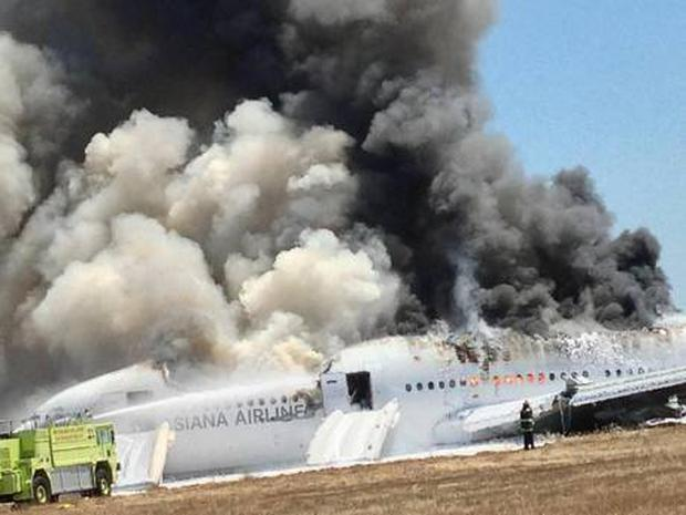 Asiana Airlines Boeing 777 is engulfed on the tarmac after crash landing at San Francisco International Airport in San Francisco, California