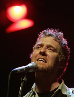 Glen Hansard performs on stage during a concert in Prague