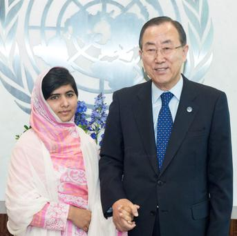 Malala Yousafzai meeting The Secretary General Ban Ki-moon before her speech at The United Nations headquarters in New York. PRESS ASSOCIATION Photo.