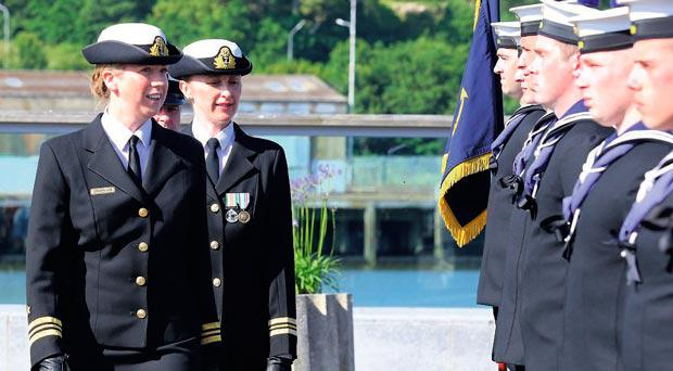 Lt Cdr Marie Gleeson (front) greeting her crew with outgoing captain Lt Cdr Erika Downing (back).