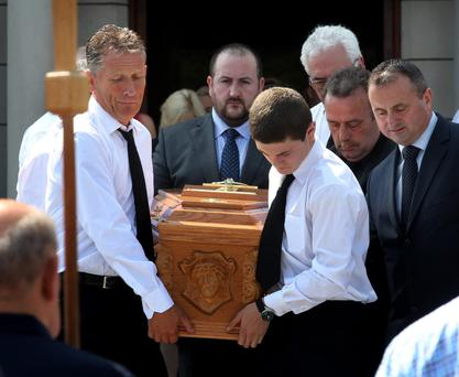 The coffin of Paul O'Brien is carried from St. Pius X Church in Templeogue