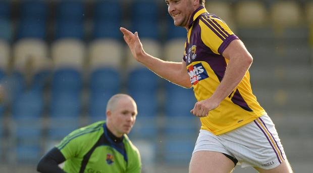 Daithi Waters, Wexford, celebrates after scoring his side's second goal