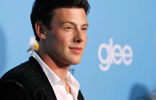 Cast member Cory Monteith poses at the premiere of the second season of the television series