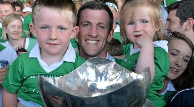 Limerick captain Donal O'Grady holds the cup, along with his children, Danny, aged 3 and a half, and Anna, aged 2, after victory over Cork.