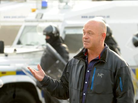 Ross Kemp filming for his new 'Extreme World' TV series at Ardoyne shopfronts in North Belfast where an Orange Order parade was about to pass today. Pic: Alan Lewis