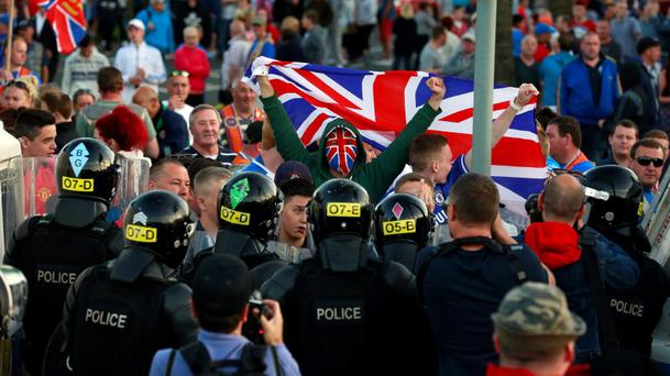 Loyalist protesters confront the police in the Woodvale Road area of North Belfast