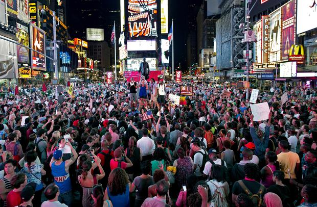 Throngs of marches gather on Times Square as they listen to a speaker, Sunday, July 14, 2013, in New York, for a protest against the acquittal of volunteer neighborhood watch member George Zimmerman in the 2012 killing of 17-year-old Trayvon Martin in Sanford, Fla