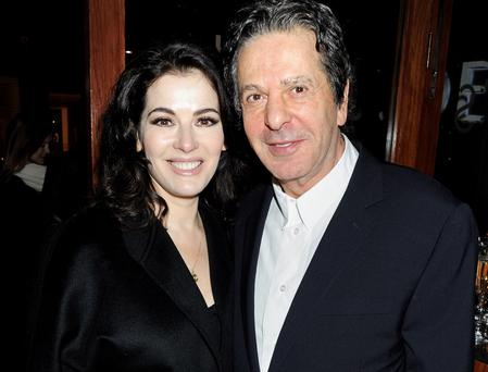 Nigella Lawson (L) and Charles Saatchi attend a dinner in January 2012