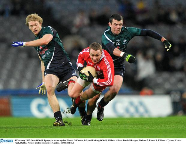 Padraig O'Neill, right, in action for Kildare against Tyrone