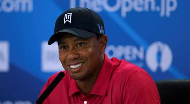 Tiger Woods of the U.S. speaks during a news conference following a practice round ahead of the British Open golf championship at Muirfiel