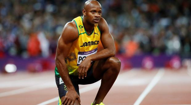 Jamaica's Asafa Powell looks at the scoreboard after running in the men's 100m final during the London 2012 Olympic Games