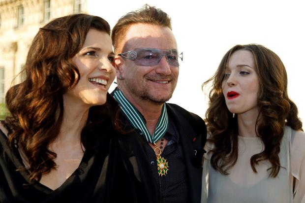 Musician Bono (C), lead singer of the band U2, poses with his wife Ali Hewson and their daughter Eve Hewson (R) after being awarded as Commandeur des Arts et lettres (Commander in the Order of Arts and Letters) by French Culture Minister Aurelie Filippetti during a ceremony at the ministry in Paris