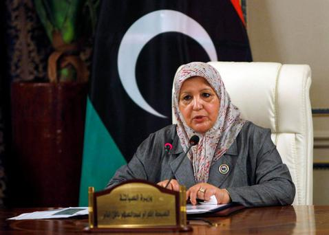 Libyan Tourism Minister Ikram Abdusalam Bash Imam speaks during a news conference in Tripoli July 16, 2013. She said the government planned to turn Muammar Gaddafi's former Tripoli compound, Bab al-Aziziya, into a park