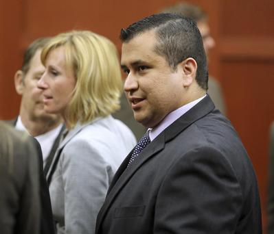 George Zimmerman leaves court with his family after Zimmerman's not guilty verdict was read in Seminole Circuit Court