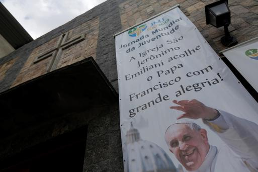 A banner promoting World Youth Day is seen at the Chapel of Sao Jeronimo, where Pope Francis is expected to visit during his upcoming trip.