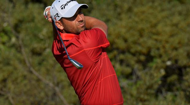 Sergio Garcia of Spain watches his tee shot on the third hole during a practice round ahead of the British Open golf championship at Muirfield