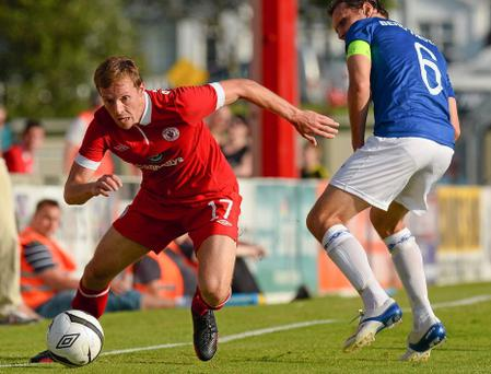 Dave McMillan, Sligo Rovers, in action against Daniel Hestad, Molde FC