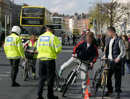 The Government is to introduce new regulations allowing gardai to impose fines of €50 against cyclists who break road safety laws, it has been learned.