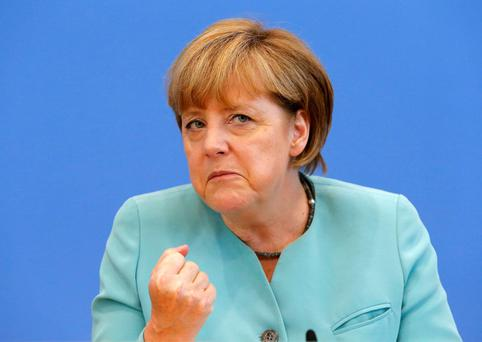 German Chancellor Angela Merkel gestures as she address media during a news conference at Bundespressekonferenz in Berlin