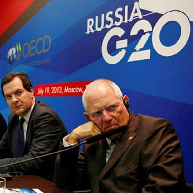 Finance ministers from Germany, Britain, Russia, France and OECD secretary-general attend a news conference, part of the G20 finance ministers and central bank governors' meeting, in Moscow